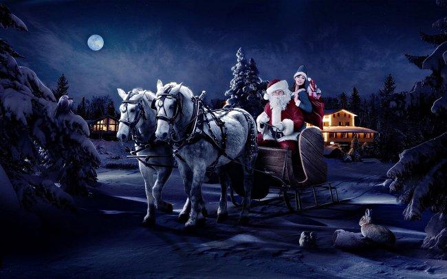 Дед Мороз и Снегурочка едут в санях