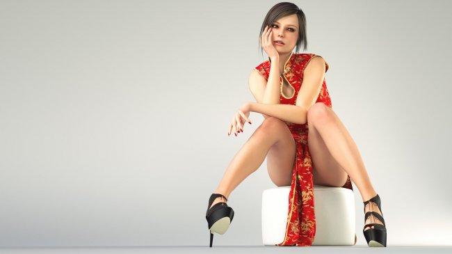 Девушка в красном платье, сидит на пуфике